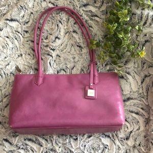 Pink leather HOBO handbag with yellow lining.